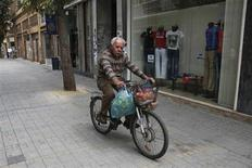 A man rides his bicycle carrying groceries in Nicosia March 30, 2013. REUTERS/Yorgos Karahalis