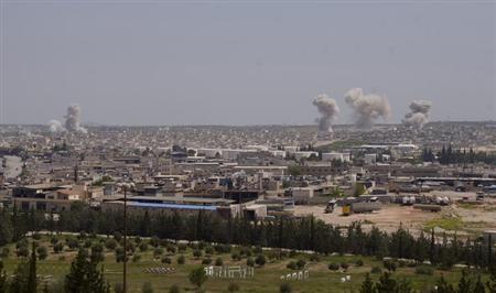 Smoke rises from Sheikh Saeed on the Airport Road near Aleppo city April 13, 2013.REUTERS/George Ourfalian