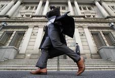A man walks past the Bank of Japan building in Tokyo March 17, 2010. REUTERS/Toru Hanai