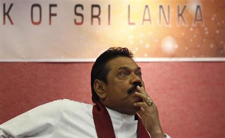 Sri Lanka's President Mahinda Rajapaksa looks on during the presentation of the 2012 Central Bank of Sri Lanka annual report, in Colombo April 9, 2013. REUTERS/Dinuka Liyanawatte