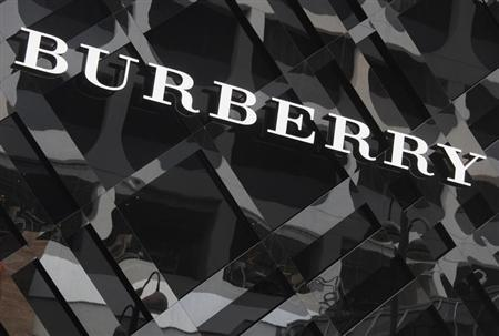 A logo of Burberry is displayed outside its store at Tsim Sha Tsui shopping district in Hong Kong January 18, 2013. REUTERS/Bobby Yip