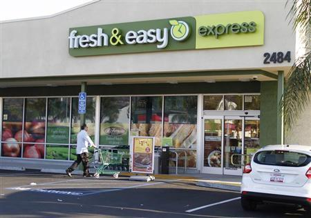 A customer pushes a cart to the entrance of a Fresh & Easy Express food market in Burbank, California October 17, 2012. REUTERS/Fred Prouser