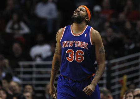New York Knicks' Rasheed Wallace reacts to a referee's call against the Chicago Bulls during the first half of their NBA game in Chicago, December 8, 2012. REUTERS/Jim Young