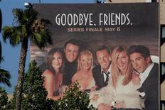 """The cast of the popular comedy television series """"Friends,"""" which will end its ten year run on May 6, 2004, are pictured on a giant billboard promoting the series finale, at the NBC television network office in Burbank, California, May 3, 2004. REUTERS/Fred Prouser"""
