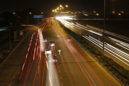 Vehicles drive on a road in New Delhi April 9, 2013. REUTERS/Adnan Abidi/Files