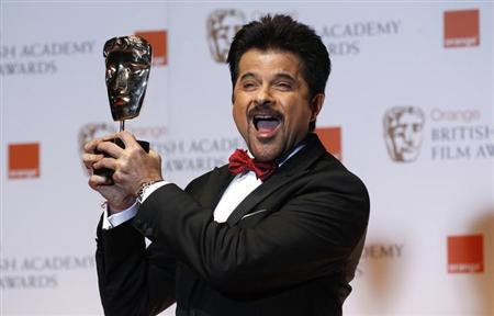 Award presenter and actor Anil Kapoor poses for photographers at the British Academy of Film and Arts (BAFTA) awards ceremony at the Royal Opera House in London February 12, 2012. REUTERS/Suzanne Plunkett