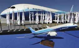 A scale model of the Boeing 787 Dreamliner sits on a table in front of an actual aircraft during the 787's certification event at Paine Field, Everett, Washington on August 26, 2011. REUTERS/Anthony Bolante