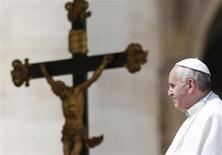 Pope Francis leaves at the end of his Wednesday general audience in Saint Peter's Square at the Vatican April 17, 2013. REUTERS/Tony Gentile