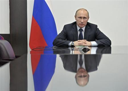 Russia's President Vladimir Putin speaks to ExxonMobil and Rosneft officials in the Pacific island of Sakhalin via a video link, as Putin visits Ulan-Ude in the Republic of Buryatia April 11, 2013 in this picture provided by RIA Novosti. REUTERS/Aleksey Nikolskyi/RIA Novosti/Pool