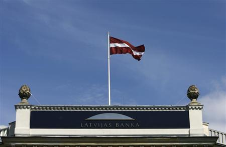Latvia's flag waves over the Central Bank's main office building in Riga May 13, 2009. REUTERS/Ints Kalnins