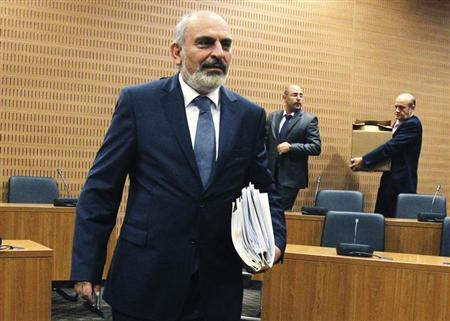 Cyprus' Finance Ministry permanent secretary Christos Patsalides, the first witness of a public inquiry into Cyprus' economic collapse, arrives to testify before a panel of judges in Nicosia April 19, 2013. The inquiry is expected to last about four months. REUTERS/Andreas Manolis