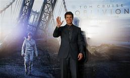 "U.S. actor Tom Cruise poses as he arrives for the world premiere of his movie ""Oblivion"" in Buenos Aires in this March 26, 2013 file photo. REUTERS/Marcos Brindicci/Files"
