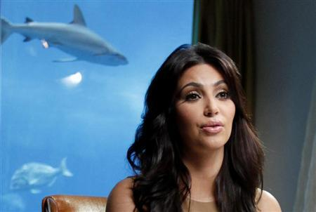 TV personality and actress Kim Kardashian speaks during an interview with Reuters in Dubai October 13, 2011. REUTERS/Jumana El Heloueh