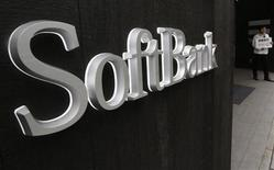 A Softbank Corp's employee stands in front of its branch in Tokyo April 17, 2013. REUTERS/Yuya Shino