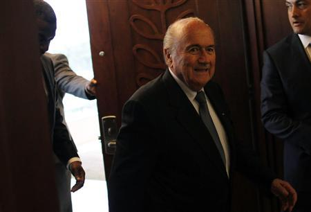 FIFA President Joseph ''Sepp'' Blatter (C) arrives for a news conference at the CONCACAF congress in Panama City April 19, 2013. REUTERS/Carlos Jasso