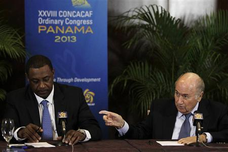 FIFA President Joseph ''Sepp'' Blatter (R) gestures next to CONCACAF President Jeffrey Webb during a news conference at the CONCACAF congress in Panama City April 19, 2013. REUTERS/Carlos Jasso