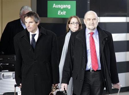 Herman Nackaerts (R), head of a delegation of the International Atomic Energy Agency (IAEA), arrives from Iran next to delegates Raphael Grossi (L) and Laura Rockwook at the airport in Vienna February 22, 2012. REUTERS/Herwig Prammer