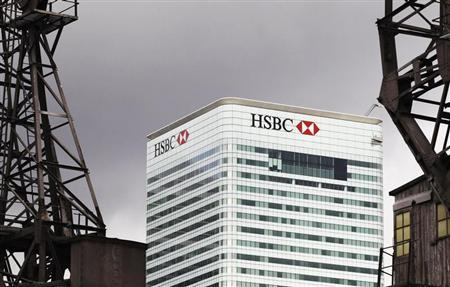 The HSBC building is seen on Canary Wharf in London May 11, 2011 HSBC Holdings Plc is to slash up to $3.5 billion in costs by cutting back in wealth management and retail banking. REUTERS/Olivia Harris
