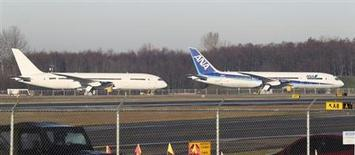 A 787 Dreamliner jet painted in All Nippon Airways (ANA) of Japan livery (R), sits idle with other 787s on the tarmac parking at Paine Field in Everett, Washington, January 17, 2013. REUTERS/Anthony Bolante