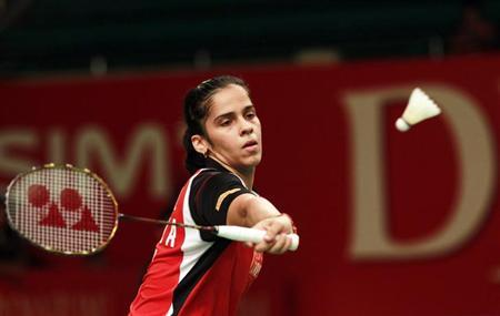 Saina Nehwal returns a shot to Aprilia Yuswandari of Indonesia during their women's singles match at the second round of Indonesia Open badminton tournament in Jakarta June 14, 2012. REUTERS/Beawiharta /Files