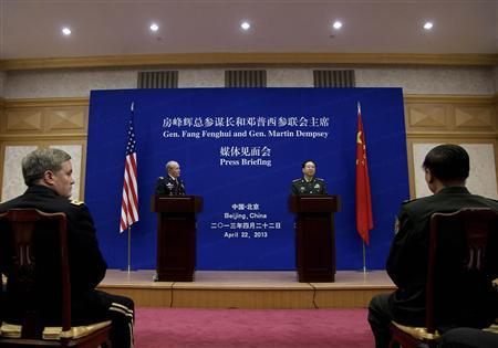 U.S. Joint Chiefs Chairman General Martin Dempsey (centre L) watches as Chief of the general staff of China's People's Liberation Army Fang Fenghui (centre R) speaks during their press briefing at the Bayi Building in Beijing April 22, 2013. REUTERS/Andy Wong/Pool