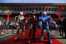 """Performers dressed as Iron Man pose for a photo during a promotional event of the movie """"Iron Man 3"""" before its release in China in early May at the Imperial Ancestral Temple of Beijing's Forbidden City, April 6, 2013. REUTERS/Jason Lee"""