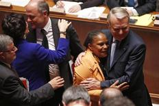 French Prime Minister Jean-Marc Ayrault (R) hugs Justice Minister Christiane Taubira (2ndR) after a final vote on bill legalising same-sex marriage at the National Assembly in Paris April 23, 2013. REUTERS/Charles Platiau