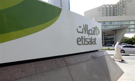 A man walks past a sign at the headquarters of telecommunications company Etisalat in Dubai October 25, 2011. REUTERS/Jumana El Heloueh