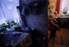 Eleonora Igaune, 71, listens to parish head Irena Kaupuze in her house in the village Morozovka near Karsava, about 300 km (186 miles) east from capital Riga in this February 28, 2012 file photo. In the 27 countries of the European Union, each pensioner is today supported on average by four people of working age. REUTERS/Ints Kalnins/Files