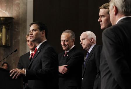 U.S. Senator Marco Rubio (R-FL)(2nd L), part of the Senate's ''Gang on Eight'', speaks during a news briefing on Capitol Hill in Washington, April 18, 2013. Pictured alongside Rubio are some of the eight senators (L-R) Jeff Flake (R-AZ), Chuck Schumer (D-NY), John McCain (R-AZ), Michael Bennet (D-CO) and Dick Durbin (D-IL), who helped craft comprehensive legislation to overhaul the immigration system. REUTERS/Jason Reed