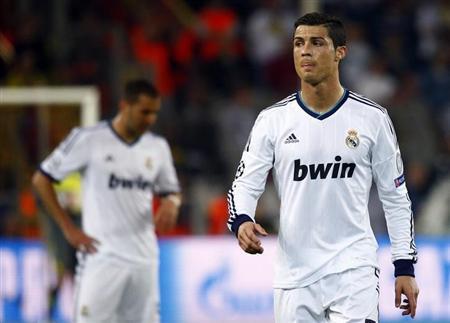 Real Madrid's Cristiano Ronaldo (R) reacts during their Champions League semi-final first leg soccer match against Borussia Dortmund in Dortmund April 24, 2013. REUTERS/Kai Pfaffenbach