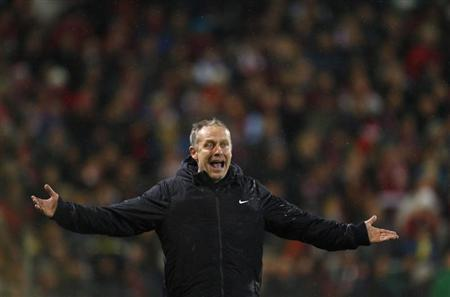 SC Freiburg's coach Christian Streich reacts during the German first division Bundesliga soccer match against Bayern Munich in Freiburg November 28, 2012. REUTERS/Lisi Niesner