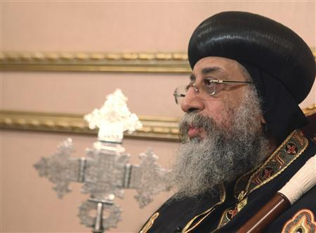 Coptic Pope Tawadros II, head of Coptic Orthodox church, talks to Reuters during an interview in Cairo, April 25, 2013. Egypt's Christians feel sidelined, ignored and neglected by Muslim Brotherhood-led authorities, who proffer assurances but have taken little or no action to protect them from violence, the pope said. In his first interview since emerging from seclusion after eight people were killed in sectarian violence between Muslims and Christians this month, the pope called official accounts of clashes at Cairo's Coptic cathedral on April 7 ''a pack of lies''. Picture taken April 25, 2013. To match Interview EGYPT-POPE/ REUTERS/Asmaa Waguih