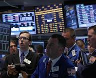 Traders work on the floor at the New York Stock Exchange, April 22, 2013. REUTERS/Brendan McDermid
