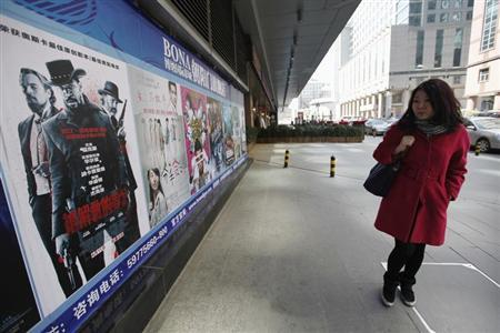 A woman looks at a poster of the film ''Django Unchained'' outside a cinema in Beijing, April 11, 2013. REUTERS/Jason Lee