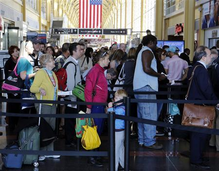 A long line of passengers wait for security at checkpoint before boarding their aircraft at Reagan National Airport in Washington, April 25, 2013. REUTERS/Larry Downing