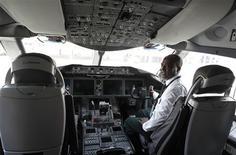 Fekadu Kebede, an Ethiopian Airlines manager, sits inside the cockpit of their 787 Dreamliner after it arrived at the Jomo Kenyatta international airport in Kenya's capital Nairobi, April 27, 2013. REUTERS/Thomas Mukoya