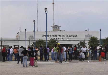 Relatives of inmates wait for information of their loved-ones after a prison riot at La Pila prison in San Luis Potosi, April 27, 2013. Thirteen people were killed and some 65 injured in a prison riot on Saturday in the central Mexican state of San Luis Potosi, local officials said. A fight broke out before daybreak among prisoners in a cell block in the La Pila prison in the state capital of San Luis Potosi, and state police re-established control by the morning, officials said. REUTERS/Stringer