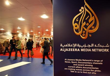 The logo of Al Jazeera Media Network is seen at the MIPTV, the International Television Programs Market, event in Cannes April 2, 2012. REUTERS/Eric Gaillard