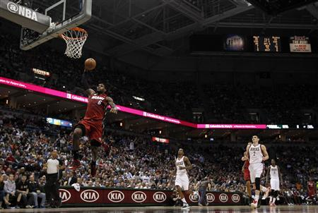 Miami Heat small forward LeBron James goes in for a dunk during the first half of Game 4 of his NBA first round playoff series against the Milwaukee Bucks in Milwaukee, Wisconsin April 28, 2013. The Heat won the game 88-77 to win the series 4-0 to advance to the next round of the playoffs. REUTERS/Jeff Haynes