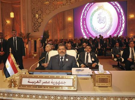 Egypt's President Mohamed Mursi attends the Arab League summit in Doha March 26, 2013. REUTERS/Egyptian Presidency/Handout