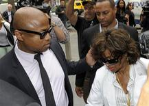 Michael Jackson's brother Randy Jackson and sister Rebbie Jackson arrive for the opening arguments in Katherine Jackson's civil suit against concert promoter AEG Live in Los Angeles April 29, 2013. REUTERS/Gus Ruelas