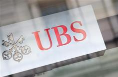 The logo of Swiss bank UBS is seen on a building in Zurich, February 13, 2013. REUTERS/Michael Buholzer (SWITZERLAND - Tags: BUSINESS LOGO) - RTR3DQGW
