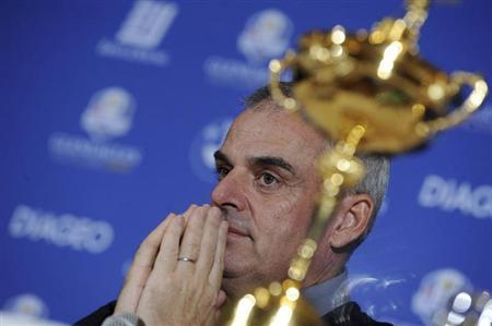 Paul McGinley of Ireland reacts near the Ryder Cup during a news conference after being named the European Ryder Cup captain at the St. Regis in Saadiyat Islands in Abu Dhabi January 15, 2013. REUTERS/Ben Job