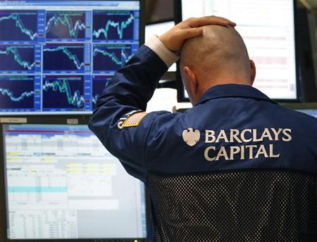 A traders watches his screen on the floor of the New York Stock Exchange February 23, 2011. REUTERS/Brendan McDermid/Files