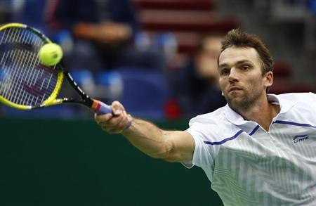 Croatia's Ivo Karlovic hits a return against Brazil's Thomaz Bellucci during their Kremlin Cup semifinal tennis match in Moscow October 20, 2012. REUTERS/Grigory Dukor