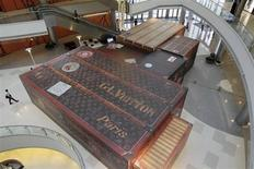 Giant suitcases for Louis Vuitton are displayed inside a shopping mall the upcoming opening the largest Louis Vuitton store in China, which is located in Shanghai, July 18, 2012. REUTERS/Aly Song