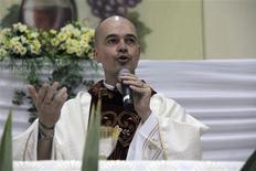 Brazilian priest Roberto Fransisco Daniel attends mass at a church in Bauru, 330 km (205 miles) northwest of Sao Paulo, in this April 28, 2013 handout. REUTERS/Malavolta Jr/Jornal da Cidade/Handout