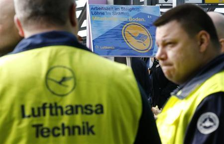 Union members attend a rally as they take part in a warning strike of German air carrier Lufthansa's ground personnel at Tegel airport in Berlin, April 22, 2013. REUTERS/Fabrizio Bensch