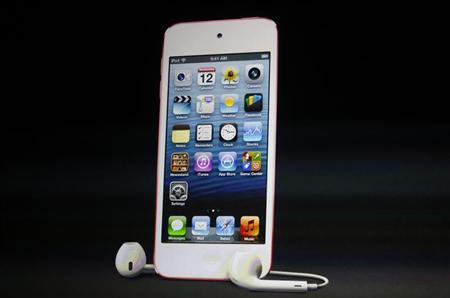 The refreshed iPod Touch with new earpods is introduced during Apple Inc.'s iPhone media event in San Francisco, California September 12, 2012. REUTERS/Beck Diefenbach